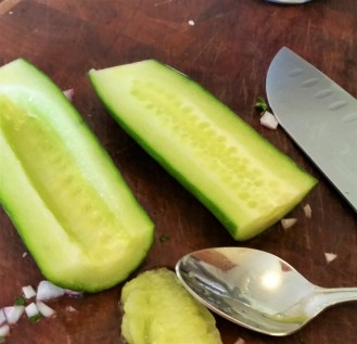 Take the seeds out of the cucumber.